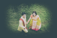 Indian Traditional Young Couple. A newly married Indian Couple in tradition dress Royalty Free Stock Images