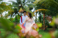 Indian Traditional Young Couple. A newly married Indian Couple in tradition dress Royalty Free Stock Photo