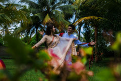 Indian Traditional Young Couple. A newly married Indian Couple in tradition dress Stock Photo