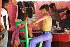 Indian tribal barber Stock Photos