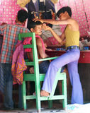 Indian tribal barber Stock Images