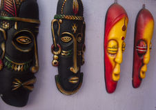 Indian tribal mask. Beautiful tribal musk of rural India hanging on a row Stock Images