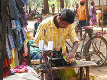 Indian tribal taylor. India, Orissa: indian tribal taylor at the tribal weekly market. The weekly market is the economic istitution in the rural area on which Royalty Free Stock Photos