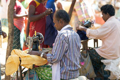 Indian tribal taylor. India, Orissa: indian tribal taylor at the tribal weekly market. The weekly market is the economic istitution in the rural area on which royalty free stock images