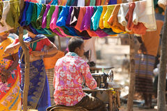 Indian tribal taylor. India, Orissa: indian tribal taylor at the tribal weekly market. The weekly market is the economic istitution in the rural area on which Royalty Free Stock Photo