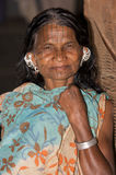 Indian tribal woman with earrings and tatto face. India, Orissa state, old tribal woman with traditional earrings and tattoo royalty free stock photo