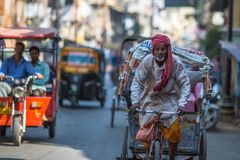 Indian trishaw on the street. According to legends, the city was founded by God Shiva about 5000 years ago. VARANASI, INDIA - MAR 21, 2018: Indian trishaw on Royalty Free Stock Images