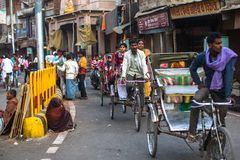 Indian trishaw on the street. According to legends, the city was founded by God Shiva about 5000 years ago. VARANASI, INDIA - MAR 21, 2018: Indian trishaw on Stock Image