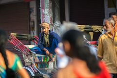 Indian trishaw waiting passengers on the street. According to legends, the city was founded by God Shiva about 5000 years ago. VARANASI, INDIA - MAR 23, 2018 Royalty Free Stock Photography