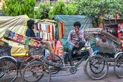 Indian trishaw waiting passengers on the street. VARANASI, INDIA - MAR 21, 2018: Indian trishaw waiting passengers on the street. According to legends, the city Stock Photography