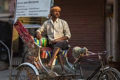 Indian trishaw waiting passengers on the street. VARANASI, INDIA - MAR 23, 2018: Indian trishaw waiting passengers on the street. According to legends, the city Stock Photography