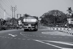 Indian truck carrying petrol on highway, B&W image. HOWRAH, WEST BENGAL, INDIA - FEBRUARY 24TH, 2018 : A petrol carriage truck is carrying petrol on the highway royalty free stock photo