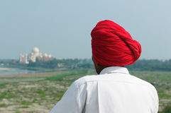The Indian in the turban is looking from Red Fort on Taj Mahal Royalty Free Stock Image