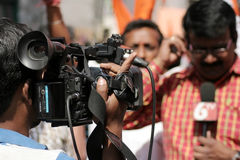Indian TV channel videographer cover the hanuman jayanti procession Royalty Free Stock Photos