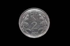 Indian two rupee coin close up on black Stock Photo