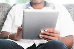 Indian using digital tablet pc Stock Photos