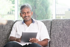 Indian using touch screen tablet pc Stock Images