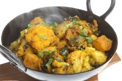 Indian Vegetable Curry. With spinach, cauliflower and potato (gobi saag aloo). Visible steam rising stock photography
