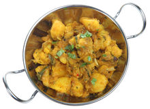 Indian Vegetable Curry. Bombay aloo vegetable curry in balti serving dish stock image