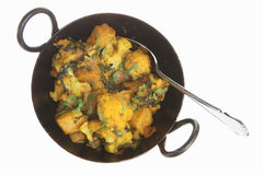 Indian Vegetable Curry. With cauliflower, spinach and potatoes (saag aloo gobi royalty free stock photography