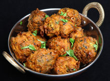 Indian Vegetable Pakora Food. Indian vegetable pakoras made from potato, spinach, cauliflower and onion Stock Images