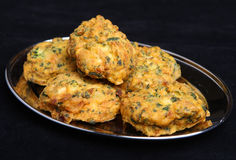 Indian Vegetable Pakoras Food. Indian vegetable pakora made from spinach, potato, cauliflower and onion Royalty Free Stock Photos