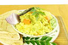 Indian vegetable rice -khichdi with tortilla bread roti or naan Stock Images