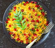 Indian vegetarian glutenfree snack Poha. Indian street food snack `Poha` also served in breakfast in Madhya Pradesh royalty free stock photos