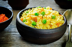 Indian vegetarian pilaf, Biriyani, with carrots and green peas Stock Images