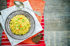 Indian vegetarian pilaf, Biriyani, with carrots and green peas Royalty Free Stock Images
