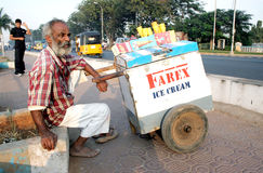Indian vendor on a busy road Royalty Free Stock Photo