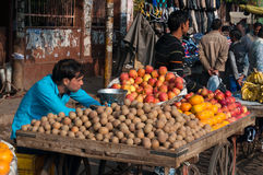 Indian vendor with fruit in market Stock Photos