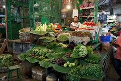 Indian vendor at the New Market, Kolkata, India. Indian vendor is selling vegetables at the New Market, Kolkata, india. New Market is an enclosed market located royalty free stock photos