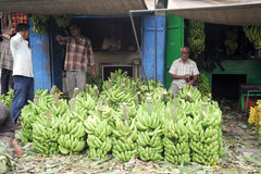 Indian vendors with banana stall in the Devaraja fruit market Stock Images