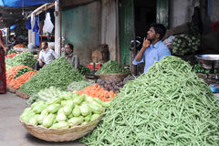 Indian vendors and customers in the Devaraja vegetable market Stock Photo