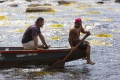 Indian Venezuelan guides at work on canoe, Canaima, Venezuela Royalty Free Stock Photography