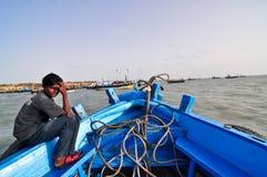 Indian village boy. An Indian village boy in a boat enroute to Dwarka,Gujarat Royalty Free Stock Image