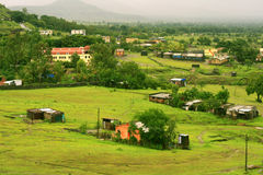 Indian village in countryside stock images