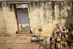 Indian village. Firewood stacked in pile in front of house Stock Image