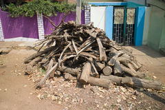 Indian village. Firewood stacked in pile in front of house Stock Photos