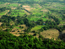 Indian village landscape. Scenic landscape view of a distant Indian village from the top of a mountain Royalty Free Stock Photos