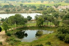 An indian village landscape of sittanavasal. An indian village landscape of sittanavasal with palm trees and small pool. tamilnadu, india Stock Photography