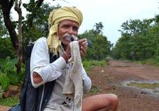 Indian village man smoking cannabis Royalty Free Stock Image