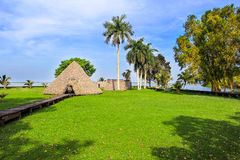 Indian village near the lake. Indian village with palms near the lake Stock Image