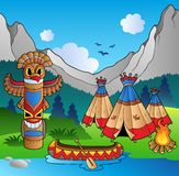 Indian village with totem and canoe. Illustration Royalty Free Stock Photography