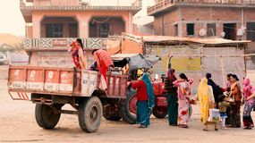 Indian village women ready to travel on tractor. Stock Photography