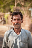 Indian villager man. Close-up of an old face of Indian villager man having wrinkle but smile on face Royalty Free Stock Photography