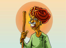 Indian villager. Indian  old villager holding a stick with smiley  face at sun rise Stock Photo