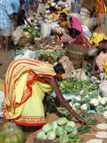Indian villagers buy dal  and other vegetables Royalty Free Stock Photo