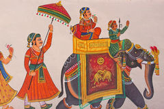 Indian Wall Painting. UDAIPUR, INDIA - MARCH 5, 2015: Wall painting in the center of the city, displaying the characteristic level of detail shown by traditional Royalty Free Stock Images
